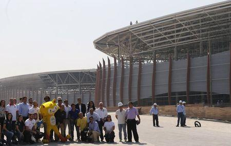 Paes poses for pictures next to the Rio 2016 Olympic mascot Vinicius and current and former Brazilian Olympians at the Olympic Park in Rio de Janeiro