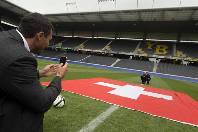 Ukraine's World Heavyweight Champion Vladimir Klitschko Snaps With His Mobile Phone A Picture Of A Swiss Flag In The AFP/Getty Images