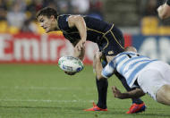 Scotland's Max Evans is tackled by Argentina's Felipe Contepomi during their Rugby World Cup Pool B match at the Wellington Regional stadium, New Zealand, Sunday, Sept. 25, 2011. (AP Photo/Natacha Pisarenko)
