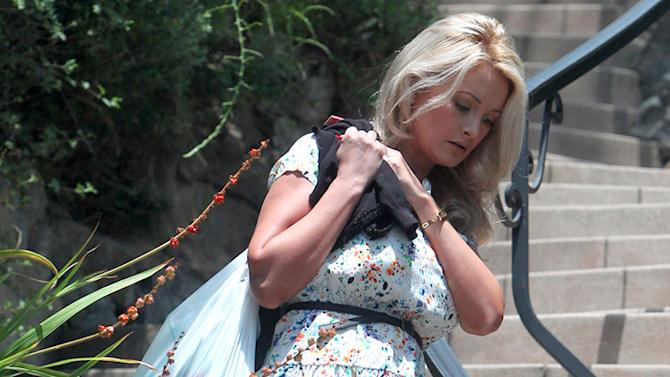 **EXCLUSIVE** Holly Madison lugs a large bag of trash before heading to a lunch date in Los Angeles