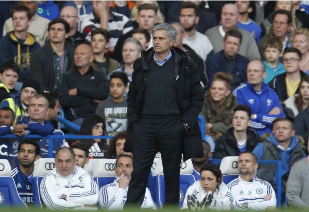Chelsea manager Jose Mourinho watches the English Premier League soccer match against Sunderland at the Stamford Bridge ground in London, Saturday, April 19, 2014. Sunderland won the match 2-1. (AP Ph