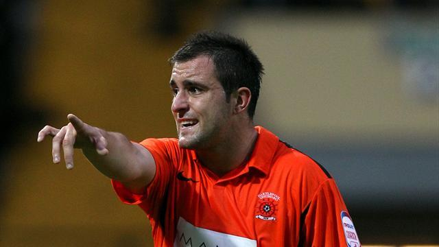 League One - Hartley makes Stevenage switch