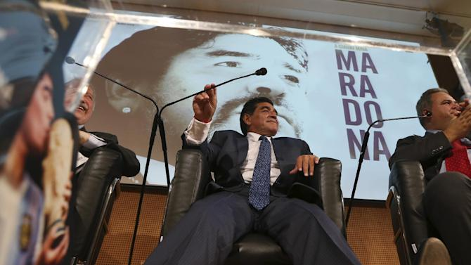 Former Argentine's soccer star Diego Armando Maradona smiles during a press conference in Milan, Italy, Thursday, Oct. 17, 2013. Diego Maradona said he would like to coach his former club Napoli. The Argentina great was in Milan on Thursday to promote a video series on his life with the Gazzetta dello Sport. Maradona also said that in four months he'll have been off drugs for 10 years