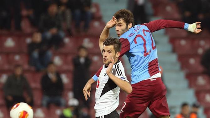 Trabzonspor's Mustafa Yumlu, left, and Legia's Broz fight for the ball during their Europa League Group J soccer match in Trabzon, Turkey, Thursday, Oct. 24, 2013. (AP Photo)