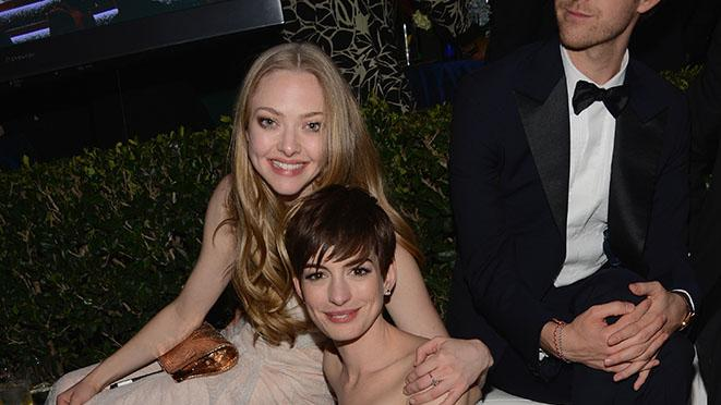 NBCUniversal Golden Globes Viewing And After Party - Inside: Amanda Seyfried and Anne Hathaway