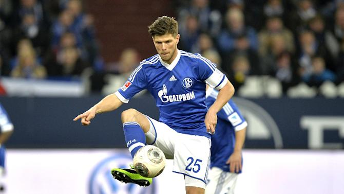 CORRECTS TO SUNDAY - Schalke's Klaas-Jan Huntelaar of the Netherlands jumps for the ball during the German Bundesliga soccer match between FC Schalke 04 and SV Hannover 96 in Gelsenkirchen,  Germany, Sunday  Feb. 9, 2014