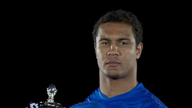 France captain Thierry Dusautoir poses for photographers with the trophy during the launch of the Six Nations Rugby Championship in London on January 25, 2012. AFP PHOTO / CARL COURT (Photo credit should read CARL COURT/AFP/Getty Images)