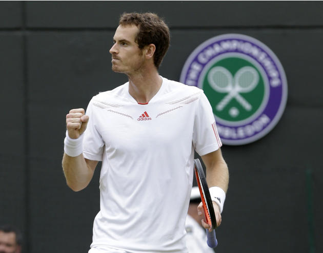 Andy Murray of Britain reacts after defeating Marin Cilic of Croatia during a fourth round singles match at the All England Lawn Tennis Championships at Wimbledon, England, Tuesday, July 3, 2012. (AP