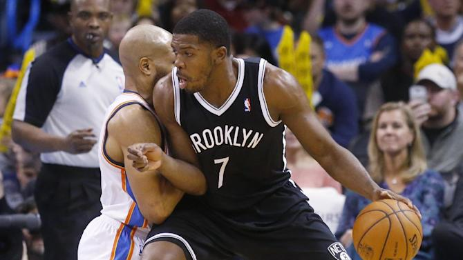 Brooklyn Nets guard Joe Johnson (7) drives against Oklahoma City Thunder guard Derek Fisher during the third quarter of an NBA basketball game in Oklahoma City, Thursday, Jan. 2, 2014. Oklahoma City won 95-93