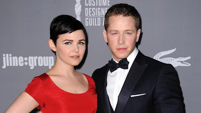 "FILE - This Feb. 19, 2013 file photo shows Ginnifer Goodwin, left, and Josh Dallas at the 15th Annual Costume Designers Guild Awards in Beverly Hills. The actors, both 35-years-old, who play Snow White and Prince Charming on ABC's ""Once Upon a Time,"" have announced their engagement. The couple met while working on the show and began dating in 2011. Goodwin was previously engaged to actor Joey Kern, while Dallas used to be married to Lara Pulver from 2007-2011. (Photo by Jordan Strauss/Invision/AP, File)"