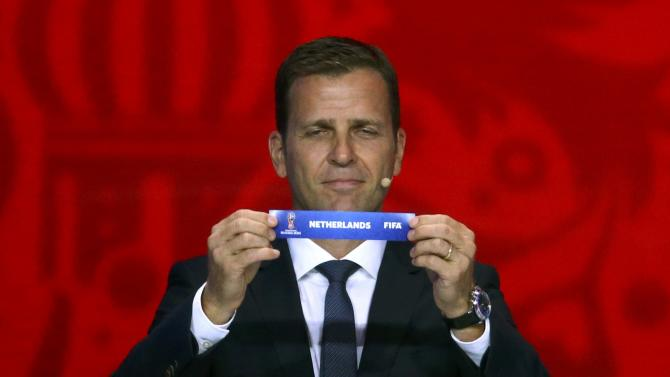 "Former German soccer player Bierhoff  holds up the slip showing the ""Netherlands"" during the preliminary draw for the 2018 FIFA World Cup at Konstantin Palace in St. Petersburg"