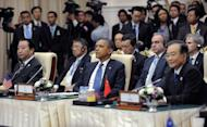 US President Barack Obama (C), Chinese Premier Wen Jiabao (R) and Japanese Prime Minister Yoshihiko Noda (L) attend an East Asian Summit Plenary Session at the Peace Palace in Phnom Penh on November 20, 2012. Obama was on Tuesday set to defy Beijing's protests and use a summit to raise concerns over South China Sea rows that have sent diplomatic and trade shockwaves across the region