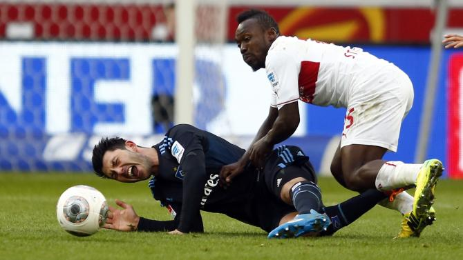 Stuttgart's Boka is challenged Hamburg's Tolgay during their German first division Bundesliga soccer match in Stuttgart