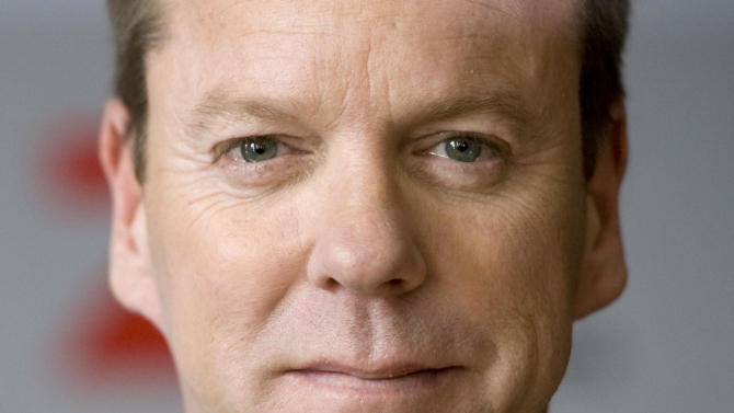 """Canadian actor Kiefer Sutherland poses during a photocall for the U.S. TV series """"Touch"""" in Berlin Germany, March 9, 2012. The series will be broadcast on German TV starting on March 25. (AP Photo/dapd, Steffi Loos)"""