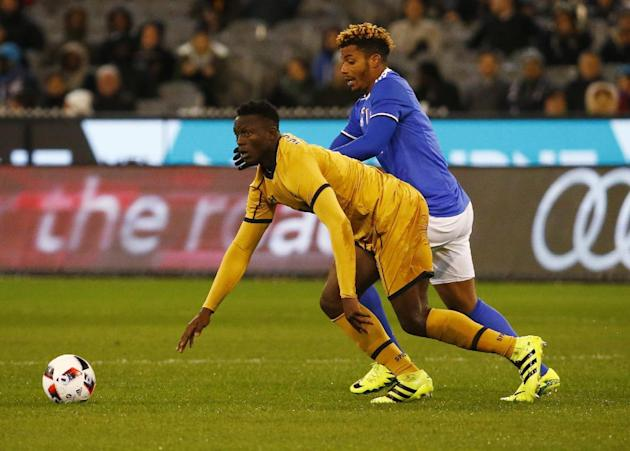 Juventus' Mario Lemina in action with Tottenham's Victor Wanyama