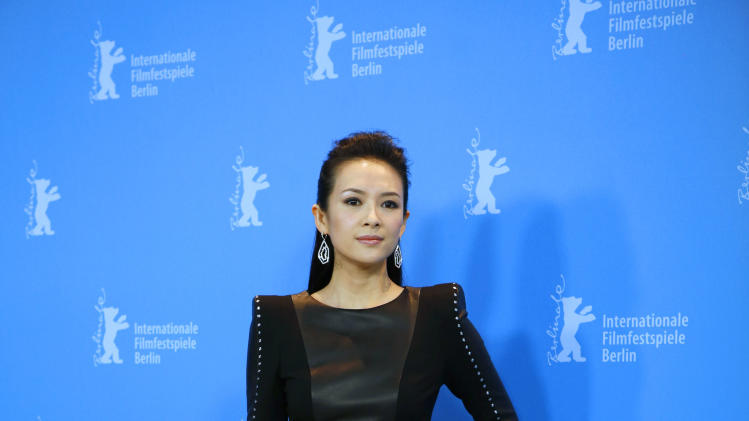 Actress Zhang Ziyi poses for photographers at the photo call for the film The Grandmaster at the 63rd edition of the Berlinale, International Film Festival in Berlin, Thursday, Feb.7,2013. (AP Photo/Gero Breloer)