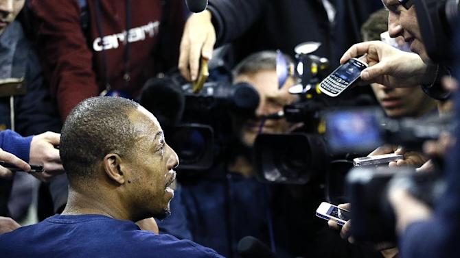 Brooklyn Nets player Paul Pierce is surrounded by media during a training session at the O2 Arena in London, Wednesday, Jan. 15, 2014.  The Atlanta Hawks will play the Brooklyn Nets in an NBA match at the O2 Arena on Thursday