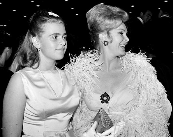FILE-This June 20, 1963 file photo Zsa Zsa Gabor, right, and her 16-year-old daughter Francesca Hilton are seen arriving for a premiere in the Hollywood. Publicist Edward Lozzi says Hilton died Monday, Jan. 5, 2015 at Cedars-Sinai Medical Center after an apparent heart attack and stroke. She was 67. (AP Photo/Harold P. Matosian, File)
