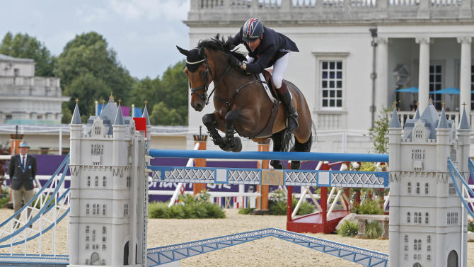 Britain's Peter Charles rides Vindicat during the equestrian individual jumping third qualifier in Greenwich Park at the London 2012 Olympic Games