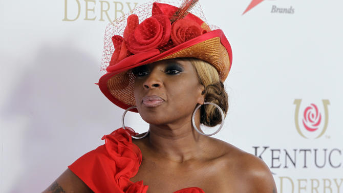 "FILE - In this May 5, 2012 file photo, singer Mary J Blige arrives for the 138th Kentucky Derby horse race at Churchill Downs, in Louisville, Ky. Blige says the Burger King commercial that caused major backlash for the singer was a ""mistake."" The clip was released in April and featured Blige singing about the fast-food chain's new chicken snack wraps. It immediately went viral, and some in the black community said it was stereotypical. Burger King pulled it after one day and said it was unfinished. (AP Photo/Darron Cummings, File)"