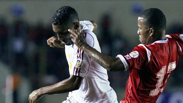 Cuba's Marcel Hernandez, seen here with Panama's Luis Henriquez, scored Cuba's winning goals against Trinidad and Tobago to win the Caribbean Cup (AFP)