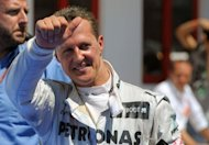 Mercedes' German driver Michael Schumacher celebrates in the parc ferme at the Valencia Street Circuit in Valencia after taking third place of the European Formula One Grand Prix