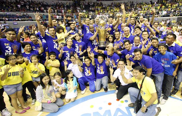 The Talk 'N Text Tropang Texters celebrate after beating the Rain or Shine Elastopainters, 105-82, to win the Philippine Cup. (PBA Images)