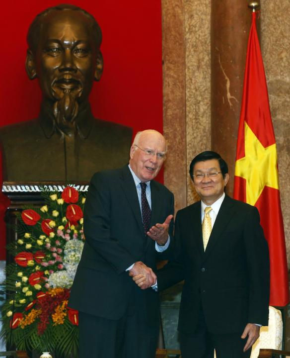 Vietnam's President Truong Tan Sang poses for a photo with U.S. Senate Judiciary Committee Chairman Patrick Leahy (D-VT) in front of a bust of late Vietnamese revolutionary leader Ho Chi Minh at t