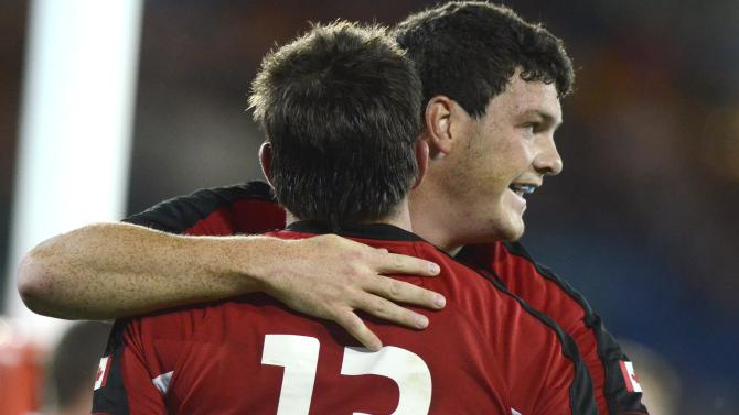 Canada's Ciaran Hearn congratulates DTH Van der Merwe (13) after scoring a try during their rugby union match against the Australian Barbarian's on the Gold Coast, Australia, Friday, Aug. 26, 2011. (AP Photo/Steve Holland)