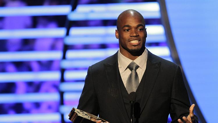 Adrian Peterson of the Minnesota Vikings accepts the NFL.com Fantasy Player of the Year award at the 2nd Annual NFL Honors on Saturday, Feb. 2, 2013 in New Orleans. (Photo by AJ Mast/Invision/AP)
