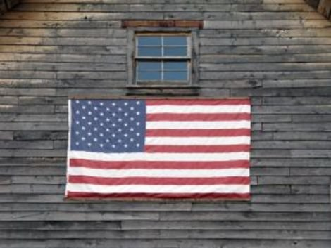 An American flag on an old building.