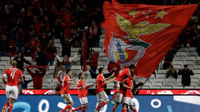 Benfica players celebrate after scoring the opening goal during their Portuguese league soccer match with Sporting Tuesday, Feb. 11 2014, at Benfica's Luz stadium in Lisbon