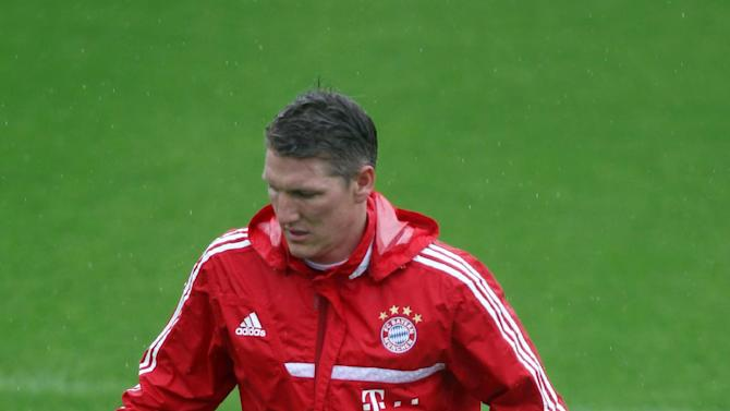 Bayern Munich's Bastian Schweinsteiger controls the ball during a training session at the ASPIRE Academy for Sports Excellence in Doha,Qatar, Saturday, Jan. 11, 2014