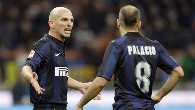 Inter Milan's Cambiasso talks to Palacio during their Italian Serie A soccer match against Udinese at San Siro stadium in Milan