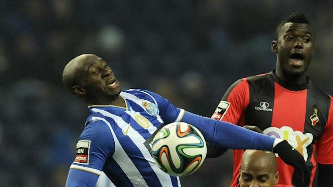 """FC Porto's Eliaquim Mangala, from France, challenges Olhanense's Pedro Celestino, centre, and Judilson """"Pele"""" Gomes, right, in a Portuguese League soccer match at the Dragao Stadium in Porto, Portugal, Friday, Dec. 20, 2013"""