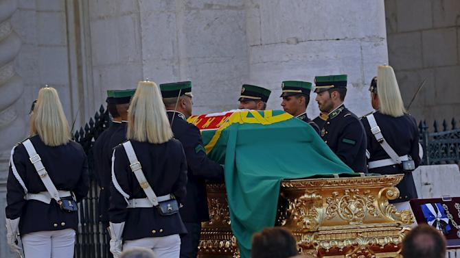 National Guard members carry the coffin of Portuguese soccer legend Eusebio during the transfer ceremony to the National Pantheon in Lisbon