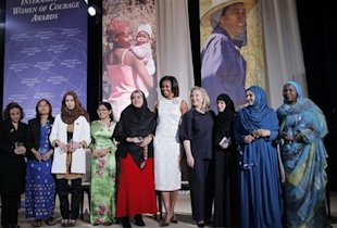 Secretary of State Hillary Rodham Clinton and first lady Michelle Obama with the recipients of the 2012 International Women of Courage Award. (AP Photo/Charles Dharapak)