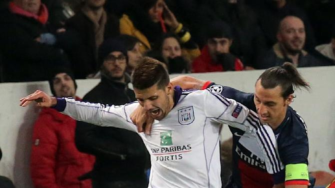 PSG's Zlatan Ibrahimovic, right, challenges for the ball with Anderlecht's Alexandar Mitrovic during their Champions League group C soccer match against Paris Saint Germain in Paris, France, Tuesday, Nov. 5, 2013. The match ended in a 1-1 draw