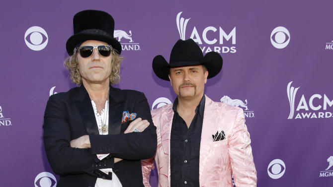 "FILE - This April 1, 1012 file photo shows Big Kenny, left, John Rich, of musical group Big and Rich, arriving at the 47th Annual Academy of Country Music Awards in Las Vegas.  After a five-year break, Big & Rich are putting the funny back in country music _ with the help of Jon Bon Jovi and Richie Sambora.The unlikely quartet gathered to write two songs for the country duo's new album ""Hillbilly Jedi"" after they struck up a friendship a few years back. (AP Photo/Isaac Brekken, file)"