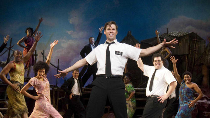"FILE - In this file theater publicity image provided by Boneau/Bryan-Brown, Andrew Rannells, center, performs with an ensemble cast in ""The Book of Mormon"" at the Eugene O'Neill Theatre in New York. Most Broadway shows had a lot to be thankful for this Thanksgiving; box offices jumped more than $6 million from the previous week. Some of the biggest winners were ""The Book of Mormon"" and ""Annie,"" which both set house records.  (AP Photo/Boneau/Bryan-Brown, Joan Marcus, File)"