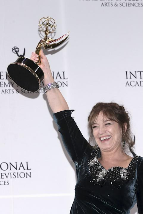 Anneke von der Lippe from Norway, poses with the International Emmy Best Performance by an Actress award, for her performance in Øyevitne (Eyewitness) during the 43rd International Emmy Awards in Man