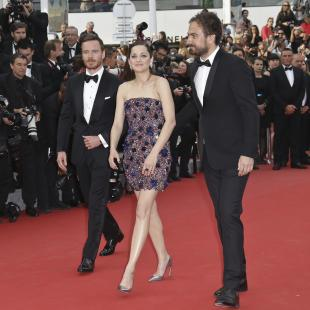 Michael Fassbender, Marion Cotillard and director Justin Kurzel pose for photographers upon arrival for the screening of the film Macbeth at the 68th international film festival, Cannes, southern France, Saturday, May 23, 2015. (Photo by Joel Ryan/Invision/AP)
