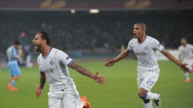 Porto's Ricardo Quaresma, left, celebrates after scoring during an Europa League, round of 16 return-leg soccer match against Napoli at the Naples San Paolo stadium, Italy, Thursday, March 20, 2014
