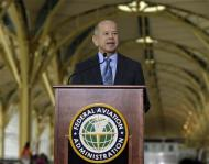 Federal Aviation Administration (FAA) Administrator Michael Huerta discusses the agency's response and recommendations from the Portable Electronic Devices Aviation Rulemaking Committee at Reagan National Airport in Washington October 31, 2013. REUTERS/Gary Cameron