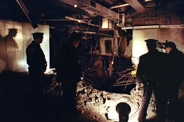 FILE-- In this Feb. 27, 1993 file photo, Port Authority and New York City Police officers view the damage caused by a truck bomb that exploded in the garage of New York's World Trade Center the pr