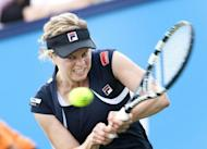 Belgium's Kim Clijsters returns the ball to Swiss player Romina Oprandi during the first round of the Unicef Open Tennis tournament in Rosmalen. Clijsters defeated Romina Oprandi 6-7 (5) 6-2 6-3. Kim Clijsters made a winning return to action on Sunday, beating Switzerland's Romina Oprandi 6-7 (5/7), 6-2, 6-3 in the first round of the s-Hertogenbosch grasscourt tournament