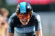 Great Britain's Christopher Froome competes at the end of the 41,5 km individual time-trial and ninth stage of the 2012 Tour de France cycling race starting in Arc-et-Senans and finishing in Besancon, eastern France