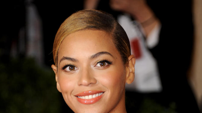 "FILE - This May 7, 2012 file photo shows Beyonce Knowles at the Metropolitan Museum of Art Costume Institute gala benefit, celebrating Elsa Schiaparelli and Miuccia Prada in New York. Songwriter Diane Warren, who wrote the ballad ""I Was Here"" for Beyonce's latest album ""4,"" says she's writing material for the megastar's upcoming album. (AP Photo/Evan Agostini, file)"