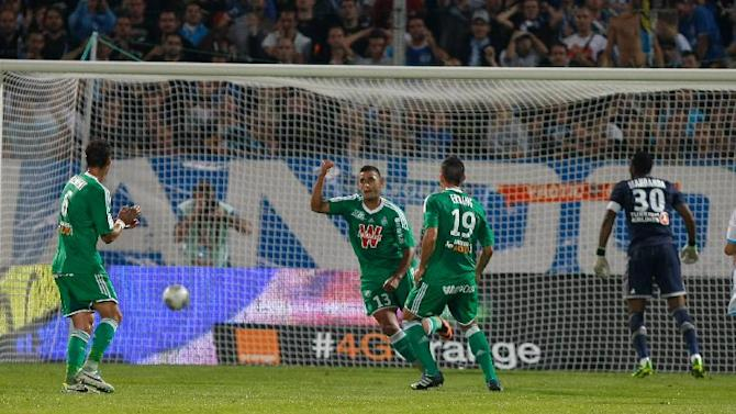 Saint-Etienne's French defender Faouzi Ghoulam, center, reacts after scoring a penalty against Marseille, during their League One soccer match, at the Velodrome Stadium, in Marseille, southern France, Tuesday, Sept. 24, 2013