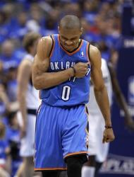 Oklahoma City Thunder's Russell Westbrook (0) pounds his chest after scoring a 3-point basket against the Dallas Mavericks in the second half of Game 3 in an NBA basketball first-round playoff series Thursday, May 3, 2012, in Dallas. (AP Photo/Tony Gutierrez)